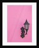 Street lamp on pink wall of Colonial style building by Corbis