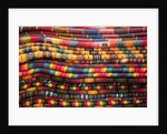 Textiles for sale in market in San Miguel de Allende by Corbis