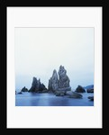 Dramatically Shaped Sea Stacks in Ocean by Corbis