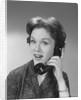 Happy smiling woman having telephone conversation by Corbis