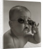 Baby wearing granny glasses sunglasses by Corbis