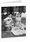 Man woman couple having a summer picnic outdoors drinking beer by Corbis