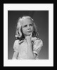 Blond girl portrait finger to chin thinking serious expression by Corbis