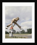 Boy jumping over fire hydrant by Corbis