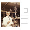 Scientist conducting a titration experiment by Corbis