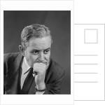 Portrait depressed worried older businessman hand to chin by Corbis
