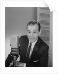 Man speaking into microphone radio tv announcer broadcaster by Corbis