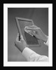 Male hands wiping slate clean by Corbis