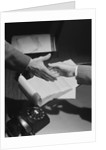 Close-up two male hands about to shake over desk with papers and telephone by Corbis