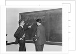 2 students professors mathematicians blackboard studying complex equations by Corbis