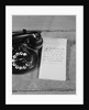 Rotary telephone note pad with phone message by Corbis