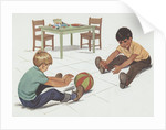 Boys playing with ball by Corbis