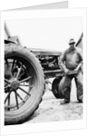 Farmer is a blur of activity working on his tractor, ca. 1938 by Corbis