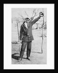 Teenage boy plays catch, ca. 1912 by Corbis