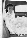 Bride in the backseat of car, ca. 1950 by Corbis