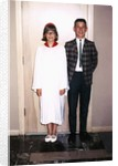 Grade school graduate with her brother, ca. 1966 by Corbis