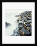 Fog at basalt columns of Giants Causeway by Corbis