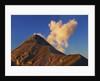 Ash eruption of Fuego volcano against blue sky by Corbis