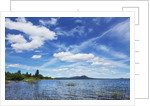 Scenic mountain lake and clouds by Corbis