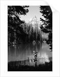 1960s man fishing holding net and rod wyoming grand teton national park string lake by Corbis