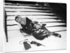 1950s woman lying on snow covered steps fall accident slip expression of pain by Corbis