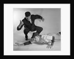1950s baseball umpire calling sliding player out studio shot by Corbis