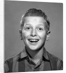 1960s portrait smiling wide-eyed happy surprised teenage boy looking at camera by Corbis