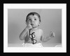 1960s baby in diaper chewing on eyeglasses by Corbis