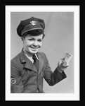 1920s 1930s 1940s smiling boy wearing a western union uniform and hat holding a telegram looking at camera by Corbis