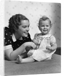 1930s smiling mother and happy child looking at camera by Corbis
