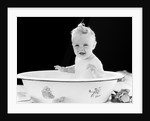 1930s 1940s smiling happy baby sitting in enameled tin bathtub by Corbis