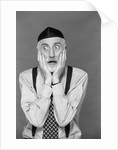 1990s portrait jewish man gray beard wearing yarmulke both hands on face funny expression oy vey shock fear worry despair by Corbis