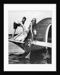 1920s man and woman in bathing suits crabbing off old abandoned wooden boat by Corbis