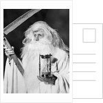 1950s costume elderly man long beard angel of death sickle scythe hourglass father time by Corbis