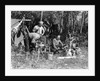 1930s three men at campsite one washing his face at tripod wash stand the other tending campfire lake of the woods ontario canada by Corbis