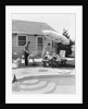 1960s summer outdoor family of four backyard barbeque by pool father grilling mother serving lemonade to son and daughter by Corbis