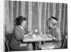 1960s two women having lunch in coffee shop restaurant by Corbis