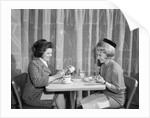 1960s two women having lunch in coffee shop restaurant by Corbis
