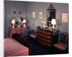1930s 1940s bedroom with blue walls pink bedspread and skirted vanity table by Corbis