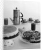 1950s coffee pot cups and saucers and two dessert cakes by Corbis