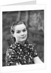 1930s portrait of brunette woman wearing printed blouse half smile mona lisa like beautiful eyes looking at camera by Corbis