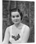 1930s brunette woman wearing white sleeveless formal dress corsage at dÆ'colletage looking at camera by Corbis
