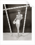 1950s 1960s woman in sexy football costume at goalpost by Corbis