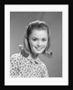 1960s portrait smiling woman wearing print blouse with flip hairdo by Corbis