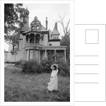 1970s woman in victorian costume standing on front lawn of large abandoned haunted victorian home by Corbis