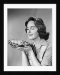 1950s 1960s woman smelling aroma of freshly baked pie by Corbis