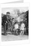 1920s group of three children watching organ grinder's monkey in costume standing on hind legs by Corbis