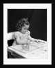1960s 1940s girl child sitting at desk drawing coloring pictures by Corbis
