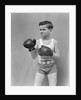 1940s boy child wearing boxing gloves standing ready to fight by Corbis