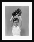 1940s boy child winner wearing boxing gloves holding hands above head looking at camera by Corbis